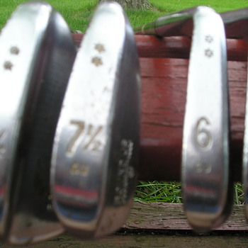 Mysterious set of Wilson RoundUp Golf clubs . with 7 1/2 and 81/2 irons.