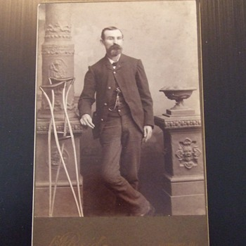 Grand Army of the Republic member with crutches cabinet card