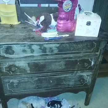 Wood dresser with wood wheels and beveled draws