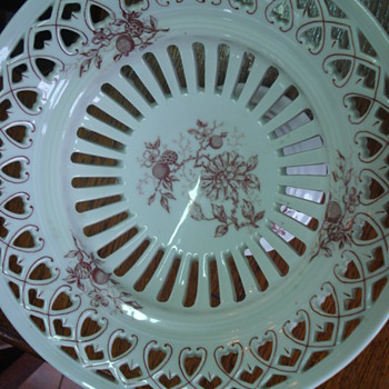 A pair of pierced footed dishes