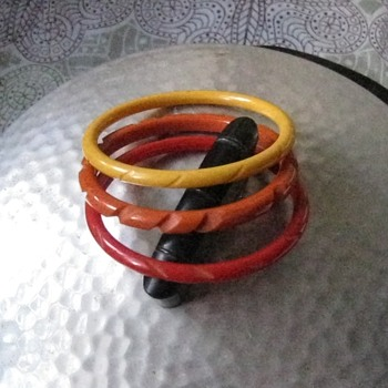 3 carved bakelite bracelets w/plus one from last year...