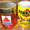 Pennzoil and citgo oil cans and glass insulators