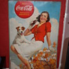 coca cola cardboard poster