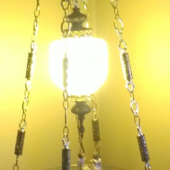 Brass hanging lamp with glass table.  Beautiful opal color on globe.