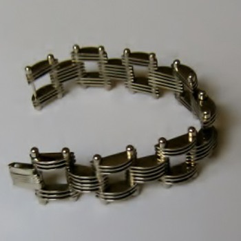 Silvertone machine disc bracelet - Costume Jewelry