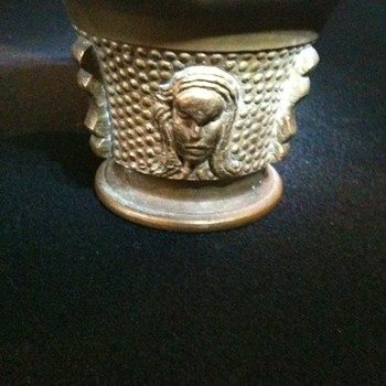 Some sort of brass  cup...