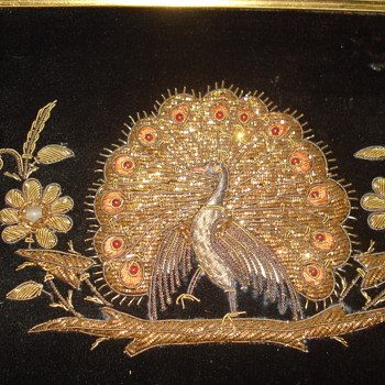 Embroidery peacock, gold silver and glass over black velvet