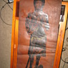 Old leather scroll with image of a dressed up man