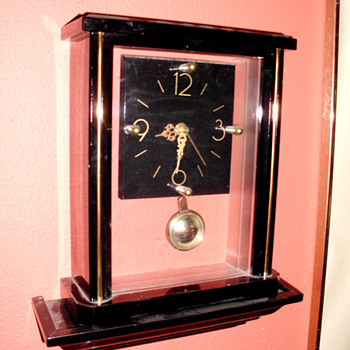 Clear Art Deco Clock on Shelf