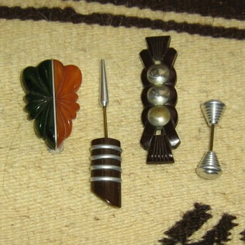 Chrome silver & bakelite clip, hatpins? and a brooch pin