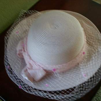 Pink women's hat with pink ribbon hat band and veil
