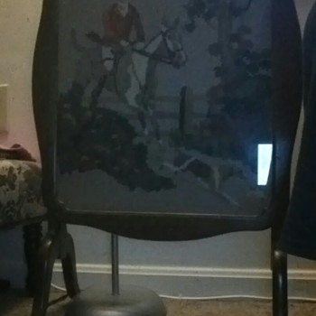 table has a neddle point picture inside i found it in the trash.
