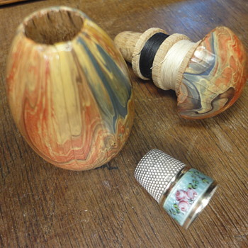 Antique wooden sewing egg with enameled silver silded thimble