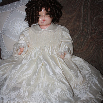 Old doll in silk dress - Dolls
