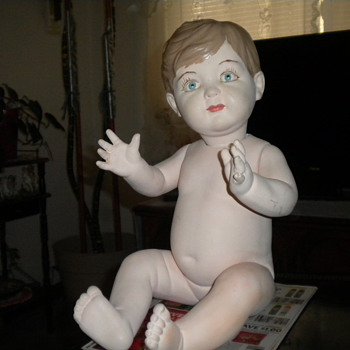 would like to find out more on this little fella - Dolls