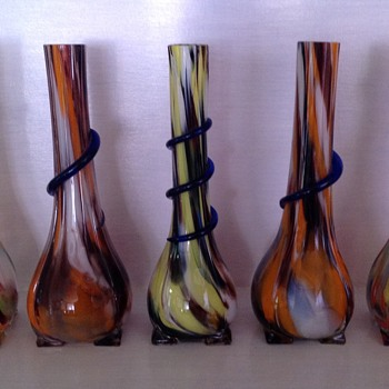 Five Czech Tango era spatter glass vases with applied serpentine trails
