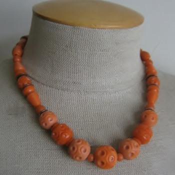 Orange carved celluloid necklace - Costume Jewelry