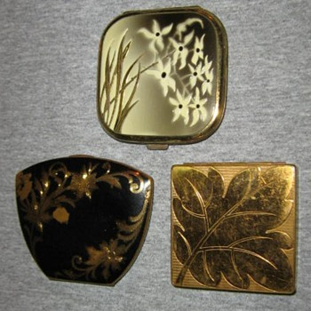 3 compacts featuring leaves