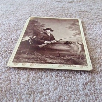 Cabinet card of Duck Hunter in a boat with his dog - Photographs