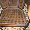 Cane wing-back chair.  Old?