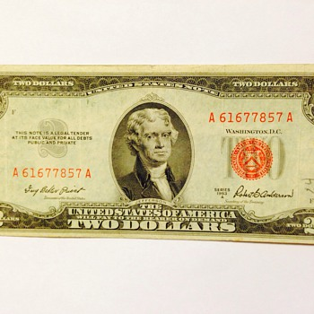 Red stamped $2 bill and silver certificate money
