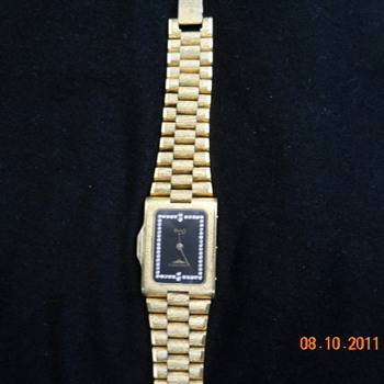 I am trying to find a value on this gift.  It is a Longines quartz - Wristwatches