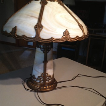 Found this lamp packed away in the attic of a mansion