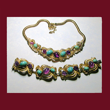 One of my favorites is this fabulous faux turquoise and amethyst demi. Signed BOUCHER   - Costume Jewelry