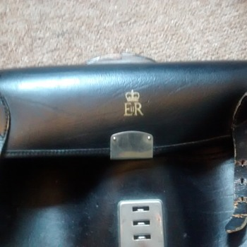 Queen Eliabeth II Personal leather Satchel marked E & R and the Crown well worn but expanding and useful.