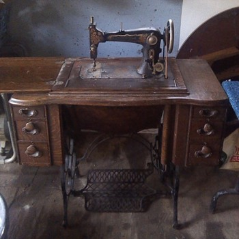 Steinway Grand treadle sewing machine in cabinet