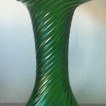 Ribbed and twisted green iridescent vase with ground pontil