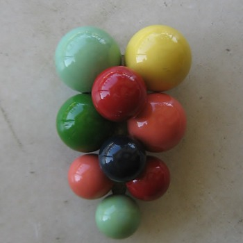Painted wood beads remind me of Christmas tree ornaments.