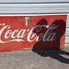 Coke cola tin 6' x 3' sign.  Good shape but one hole.  Looking to understand value of sign.