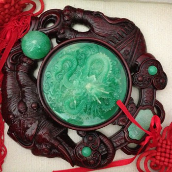 chinese 3d jade carved dragon set in teakwood stone with elephant carvings in wood.