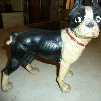 Is this Cast Iron dog Hubley or a repo ? Door stop ?