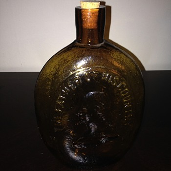 Amber colored glass flask