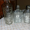 Really pretty alcohol bottles. I know ones an old Quaker but was wondering what kind  the others were. really pretty