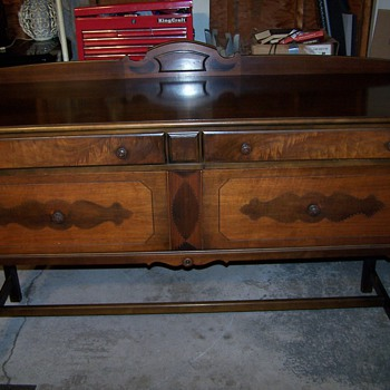 Would any one have information on this what i think is a very old buffet.  - Furniture