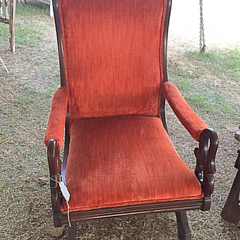 Mahogany platform rocker w/carved swan head arms and metal claw feet