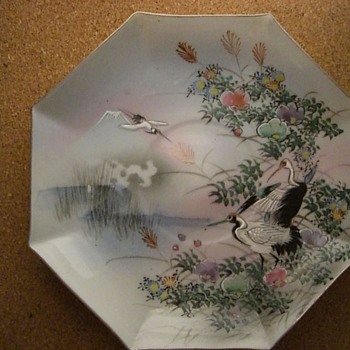 Small China Dish with artwork depicting Long Billed Birds, Floral, Waterside and Distant Mountain Scene.