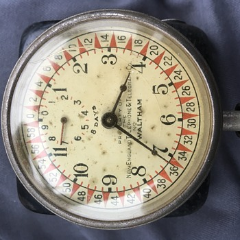 New England Telephone & Telegraph Co. marked Waltham 8-Day Car clock