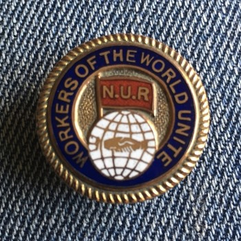NUR lapel badge