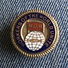NUR lapel badge