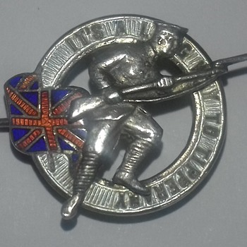 Could you tell me about this pin I have can't find it anywhere on the internet. It's about the size of a penny sterling silver  - Military and Wartime