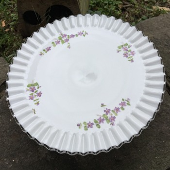 Pedestal milk glass cake dish signed but not a Fenton artist help,