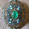 domed filigree pendant/brooch with emerald, aquamarine and turquoise stones