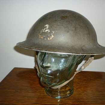 British WWII steel combat helmet. Kings Regiment Liverpool.