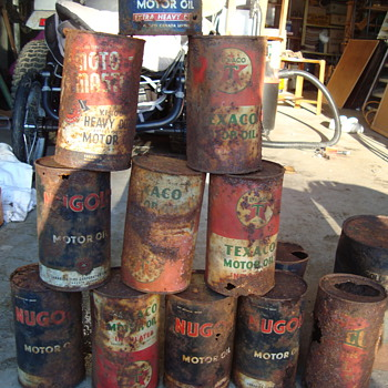 old rusted tin cans  - Petroliana