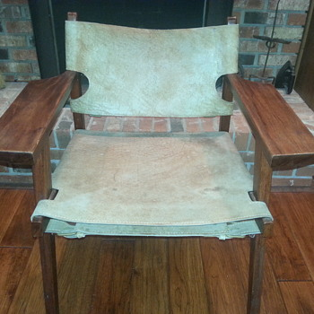 REALLY COOL LEATHER CHAIR THAT BUCKLES UNDERNEATH COW HIDE?