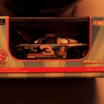"REVELL DIE CAST DALE EARNHARDT JR, 1999 CHEVY,MONTE CARLO ""SUPERMAN"" NASCAR  RACER FOR ADULTS MINT IN BOX"
